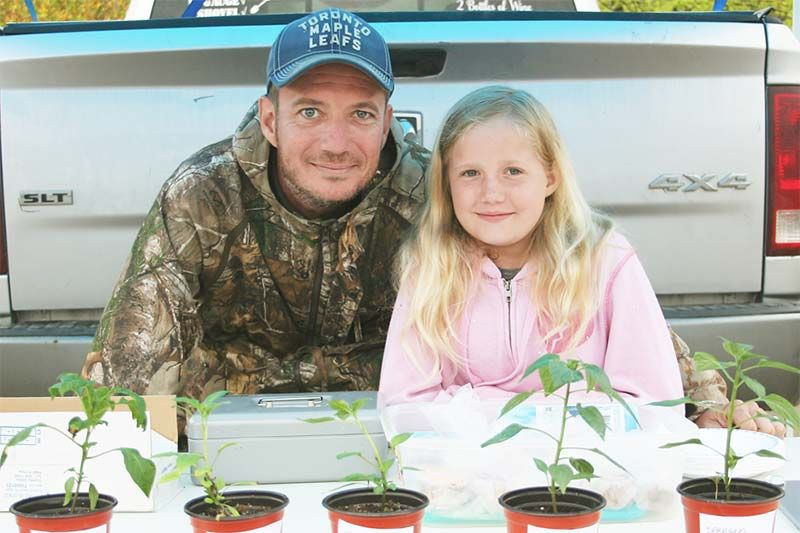 Fynn Collins along with some support from dad Mike is selling the seedlings she's grown at the Frontenac Farmers Market in Verona this summer