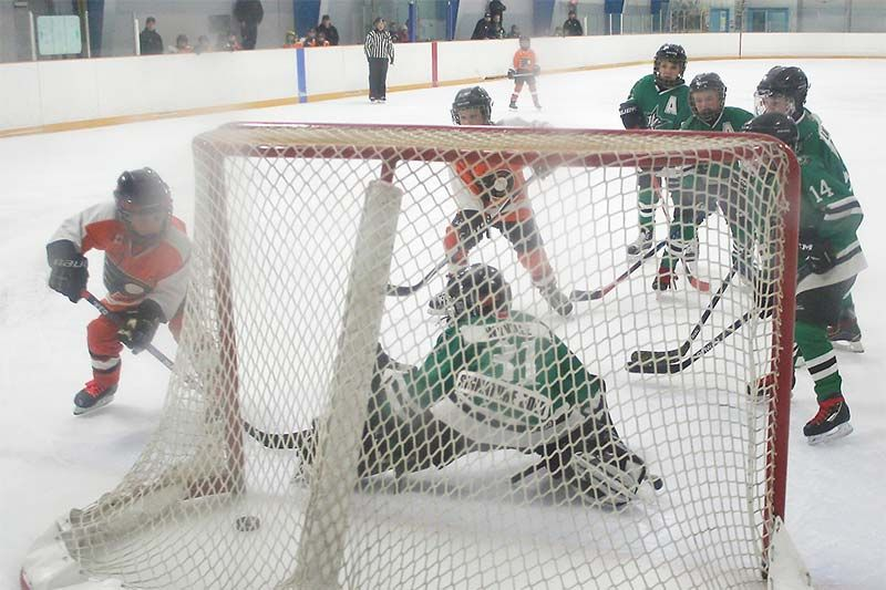 Frontenac Flyers Cole Rowat notched the home side's fourth goal at 10.02 of the second period en route to 6-3 win in the first game of the EOMHL CC-C Novice finals last Saturday at Frontenac Arena. Photo/Craig Bakay