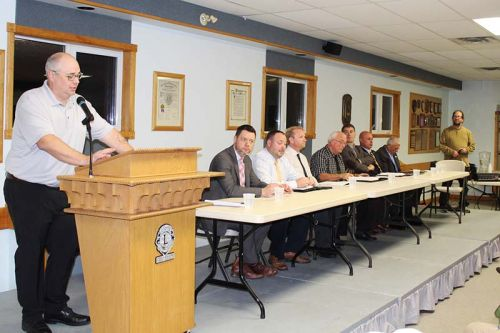 From left: Council candidates Bruno Albano, Brad Barbeau, Tom Bruce, Doug Morey and Ray Leonard; mayoralty candidates Phil Archambault, Mark Schjerning and Ron Vandewal; moderator Jeff Green. Photo/Craig Bakay
