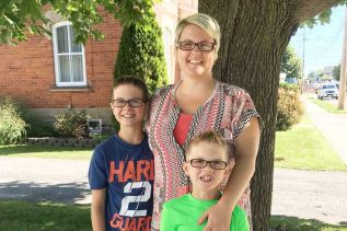 Amanda Neadow, standing with her sons Jason and Dawson, will open the JDN Center for Children. Slated for a September opening, the center will provide ABA Therapy and parent coaching support to children diagnosed with ADHD, Autism and Cognitive Deficit Disorders. Submitted Photo