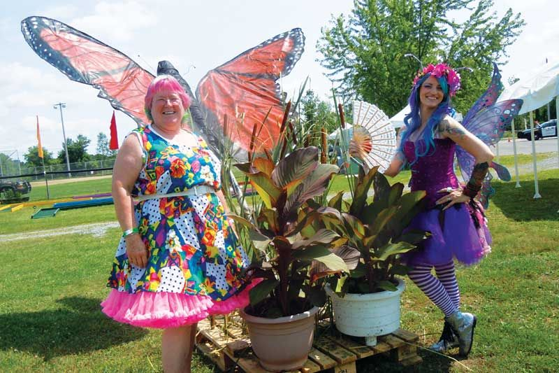 Debbie Lovegrove and Lily the Fairy strike a pose with Asselstine Hardware's butterfly float ornament