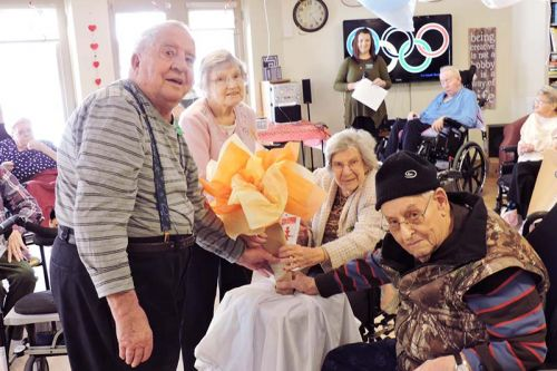 Holding the Olympic torch, left to right, Gordon Spicer, Marion McWilliams, Lily Hundey, Edmund Trudeau.