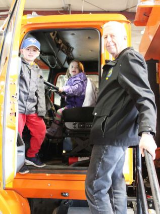 Touch the Truck is designed as a way for parents and grandparents to get out and do something with their little ones and South Frontenac Mayor Ron Vandewal was on board with that, attending with grandchildren Alexis and Brooks Vandewal (pictured) and Abby Reynolds. Photo/Craig Bakay