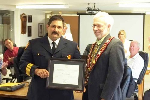 Randy Schonauer, a firefighter with Clarendon Miller, was presented with the Fire Services Exemplary Service Medal by Mayor Ron Higgins on Friday for his 20 years of service with the volunteer fire department.