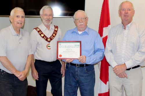 "North Frontenac's Senior of the Year, Terry Good (third from left) was honoured at Council Friday morning. Good was cited for his work with Harlowe Hall since he was 10 years old. ""It was a two-room schoolhouse when I started,"" he said. Good was presented with a fruit basket and is pictured with Dep. Mayor Fred Perry, Mayor Ron Higgins and Coun. Wayne Good. Good and Perry represent Good's district. Photo/Craig Bakay"