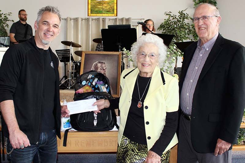 Clara Snook and Pastor Carl Bull present a check to Doug van der Horden for $6,000 that will provide First Response Bags to victims of human trafficking in the area. Photo/Craig Bakay