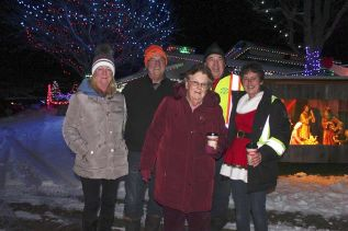 You never know who will show up at Riverhill Farm for the Christmas Light Display. On Dec. 1, MPP Randy Hillier along with his wife Jane, (they brought their grandsons) and former councilor Barb Sproule, stopped for a picture in front of the main house with Greg Ducharme and Rhonda Lemke. Photo/Craig Bakay