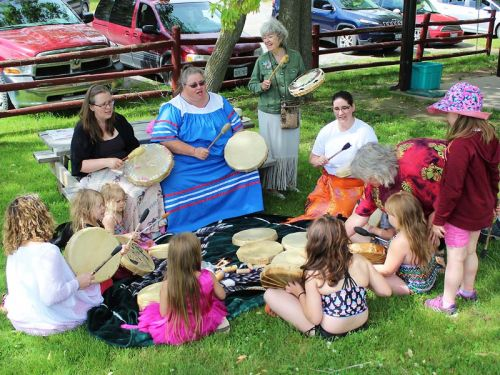 Kids of all ages joined in the drumming circle last Friday as Shabot Obaadjiwan First Nation and EarlyON welcomed visitors to Oso Beach. Photo/Craig Bakay