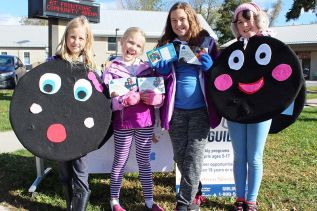 It was hard to resist the sales pitch of Girl Guides Caitlin Ball, Lilah Norton, Ella Eamer and Willa Morton Saturday in Sydenham. Photo/Craig Bakay