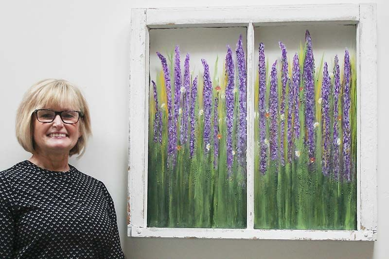 Joanne (Bertrim) with her favourite piece in the show, Fields of Lavender. Photo/Craig Bakay