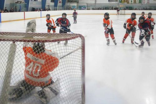 Atom Flyers goalie Tyson Young snapped the trapper on this one that was headed for glove-side high.