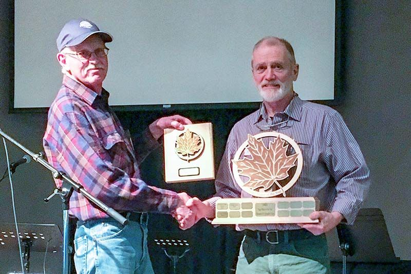 Lanark & District maple syrup producer, Dwight James (right), was presented with the Sugar Maker of the Year award by LDMSPA President, Harold Walker (left). The Sugar Maker of the Year is a prestigious award presented to long term maple producers, or those that encourage and support start-ups in maple production.