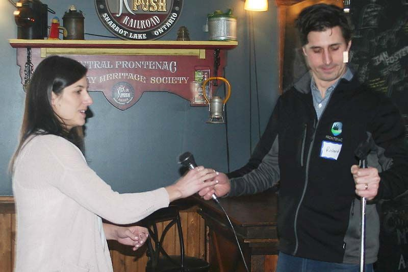 Frontenac County's manager of economic development Richard Allen passes the mike to Ontario Highlands Tourism Organization tourism development coordinator Stephanie Hessel at the Sharbot Lake Country Inn Monday.