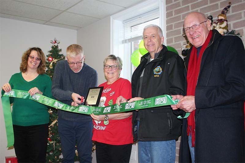 Ontario Trillium Foundation representative Bob Burge cuts the ribbon symbolizing the renovations at the Harrowsmith S & A Club Saturday along with S & A President Pam Morey, Treasurer Penny Lloyd, Mayor Ron Vandewal and Coun. John McDougall. Photo/Craig Bakay
