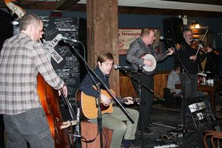 Turpin's Trail (Noah St. Amand, Jon McLurg, Chris Murphy and Brian Flynn) provided the music component of the Newfoundland Kitchen Party at The Crossing Pub in Sharbot Lake last Saturday. Photo/Craig Bakay