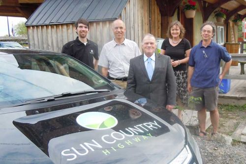 L-r, Paul Camiré, Peter Manson, Reeve/Warden Keith Kerr, Therese Steenberghe and Jeroen Kerrebijn celebrate the new EV charging station at the Fall River Restaurant in Maberly