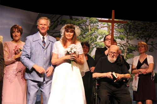 Kathy Magnusson, Brian Robertson, Margo McCullough (behind with cross), Tom Christenson (seated) and Sandy Robertson filling in for Carol Raymo in The Wedding.