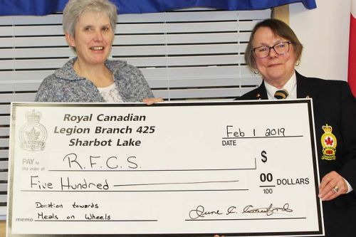 Sharbot Lake Legion President June Crawford presents a $500 cheque to Catherine Tysick, Rural Frontenac Community Services adult centre manager for Meals on Wheels.