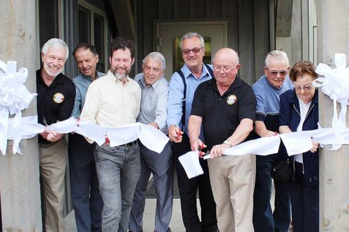 Both sitting and former politicians lined up to cut the ribbon on the revamped Township office in Plevna including (from left) Mayor Ron Higgins, Coun. John Ingles, MP Scott Reid, Coun. Vernon Hermer, MPP Randy Hillier, Coun. Gerry Martin, and former Council members Dave Smith and Barb Sproule. Photo/Craig Bakay