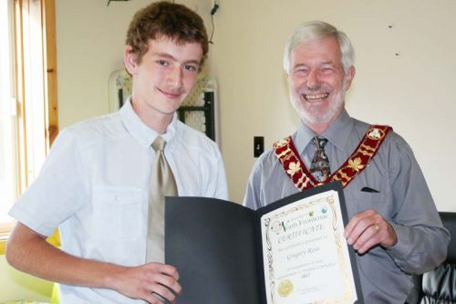 North Frontenac Student Coun. Gregory Ross's term is up and he was presented with a certificate from Mayor Ron Higgins. The 13-year-old will be going into Grade 9 at GREC and said he plans to pursue a political career, federal, provincial or municipal in the future, probably within the Conservative Party. Photo/Craig Bakay