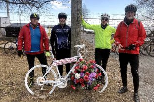 Doug Kennedy (left) with members of his riding club at 'the ghost bike' memorial for 'wheelman' Jeff Vervaike