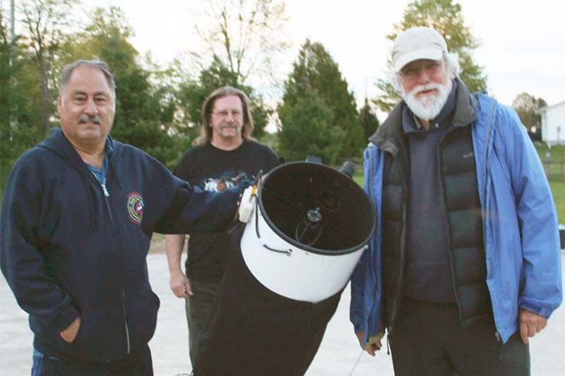 Gary Coleman, Tim Trentadue and Guy Nason set up their telescopes for the North Frontenac Dark Skies Preserve's first event of their 2017 summer stargazing season. Photo/Craig Bakay