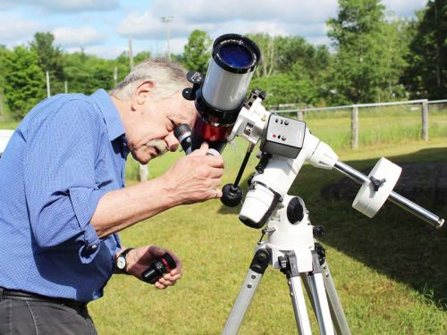 Fred Barrett wanted to give visitors a good look at the Sun Saturday. Unfortunately, the clouds got in the way.