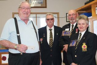 Jim Smith (l) received his 50-year ordinary member pin from President Alden McLellan, Zone Commander Ty Seeley and Patty Middleton, honours and awards chair as the Sharbot Lake Legion held its Honours and Awards and Volunteer Appreciation Banquet Saturday. Photo/Craig Bakay