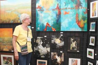 "Carla Miedema, who has exhibited in all 22 of the Bon Echo Art Exhibitions, says ""I'm an experimenter, I have fun with my art."""