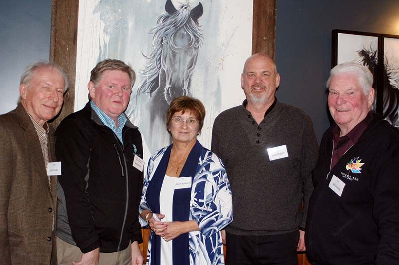 (L to R) Ken Fisher, Kelly Pender, Alison Robinson, Greg Rodgers, Bill Bowick, at the Crossings Pub in front of a painting by Jen White