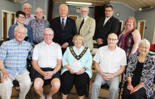Central Frontenac Seniors of the Year: Front row: Ken Fisher (Oso), Gord Brown (Kennebec), Mayor Frances Smith, Dave Willis (Olden), Heather Fox (Hinchinbrooke). Back row: Coun. Cindy Kelsey, Dep. Mayor Victor Heese, Coun. Elwin Burke, Coun. Tom Dewey, Coun. Bill MacDonald, Coun. Brent Cameron, Coun. Vicki Gowdy. Photo/Craig Bakay