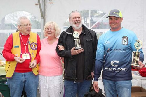 From left: Lions Paul Riddell (tournament chair), Helen Burke, Catch of the Day winner Martin Collicott and his pro guide Scott Campbell. Photo/Craig Bakay