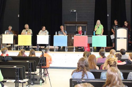 The candidates debate at GREC, from left: Independent John McEwen, Libertarian Steve Gebhardt, New Democrat Ramsey Hart, PC Randy Hillier, Liberal Amanda Pulker-Mok, Green Party Anita Payne and moderators Tyee Davis and Carrie-Lyn Shields. Photo/Craig Bakay