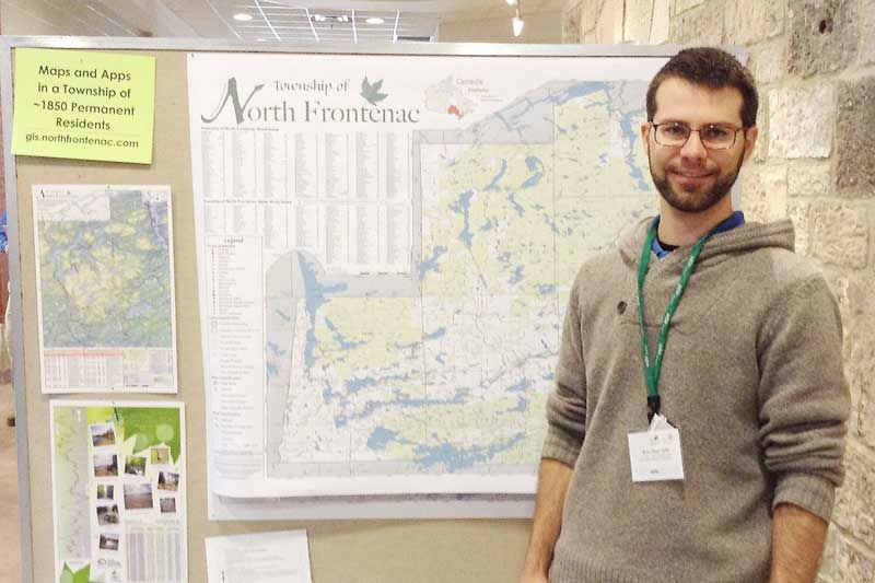 Evan Sepa with the North Frontenac wall map at the URISA – Ontario AGM in Guelph.
