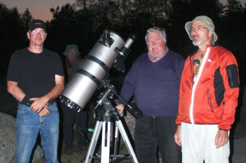 Don Vaillancourt of the North Frontenac Economic Development committee and Alex Dolnycky and Frank Dempsey of the North York Astronomical Association get ready for Saturn to make an appearance at last Saturday's star party on the pad near Plevna. Photo/Craig Bakay