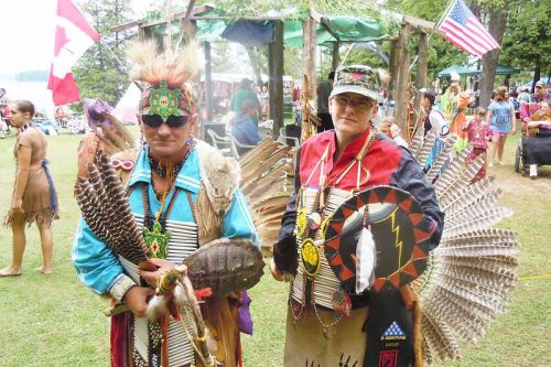 Head veteran Sharp Dopler and James prepare for a warrior dance at the Silver Lake Pow Wow