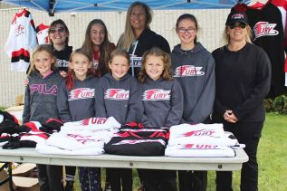 Members of the Frontenac Fury organization of all ages were out in force at the Frontenac Community Arena Sunday. Pictured: Lynn Newton, Tanya Thake, Kelly Allport, Leah Rinen, Morgan Rinen, Sydeny English, Ella Allport, Leah Rumbolt, Jenna Norman. Photo/Craig Bakay