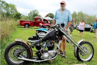 "Rob Verrier with his ""work in progress"" Triumph at the Godfrey Social Club's second annual Car and Bike Show Sunday. Photo/Craig Bakay"