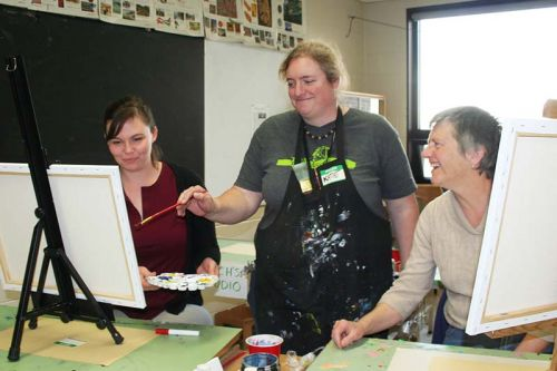 Instructor Katie Ohlke demonstrates a technique to Sarah and Donna Wood at the North Addington Education Centre's art night last Friday in Cloyne. Photo/Craig Bakay