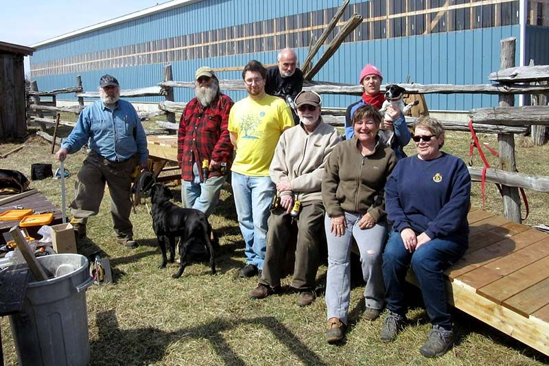 Perth Men's Shed members stopped for a photo after helping to build a ramp for a Therapeutic Riding Program in Lanark County last year