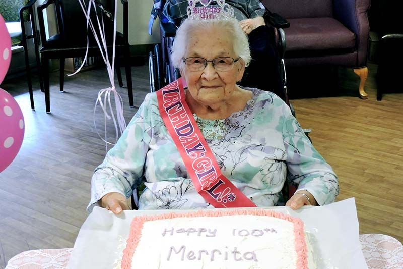 Merrita with a cake befitting the occasion