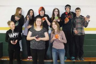 NAEC students show off their ornaments