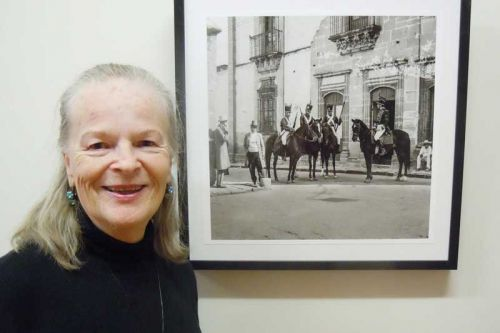 "Photographer Abigail Gossage with ""Movie Extras"" from her MERA show titled ""Memories of Mexico 1958"""