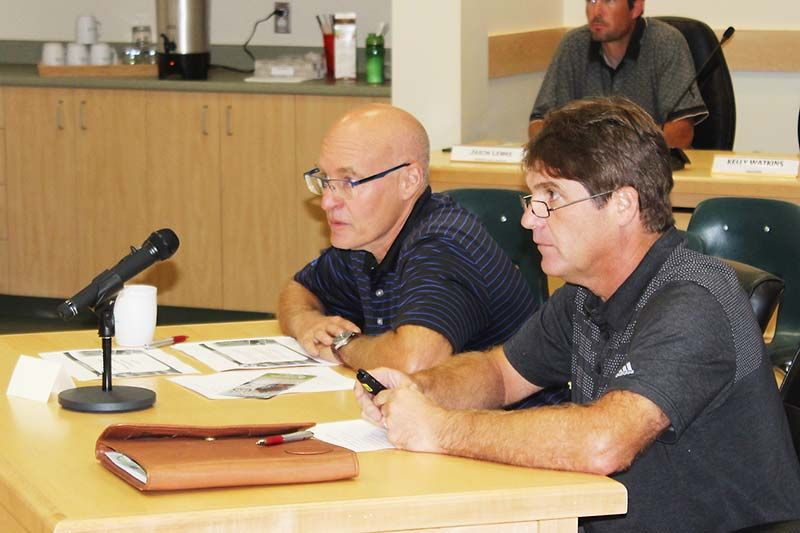 Chris Davis (l) and Greg Banks of the Bytown Motorcycle Association, outline their request for a one-day group access permit to North Frontenac Council. Photo/Craig Bakay