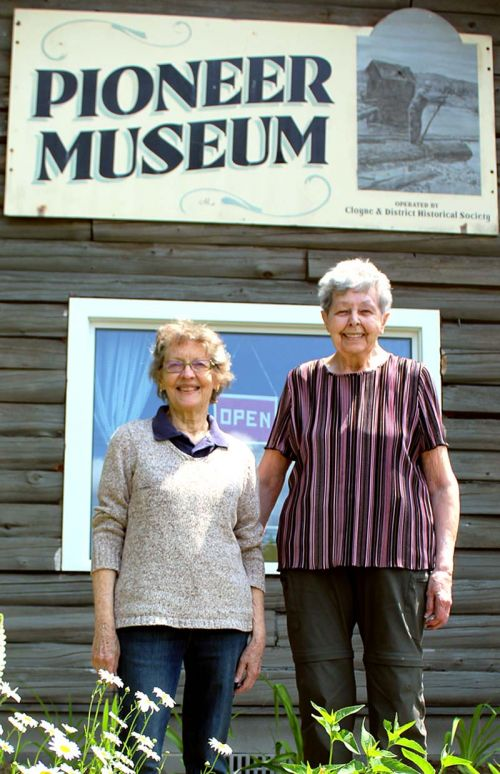 Former curator Margaret Axford and president Shirley Sedore in front of the museum at the season opening Saturday in Cloyne