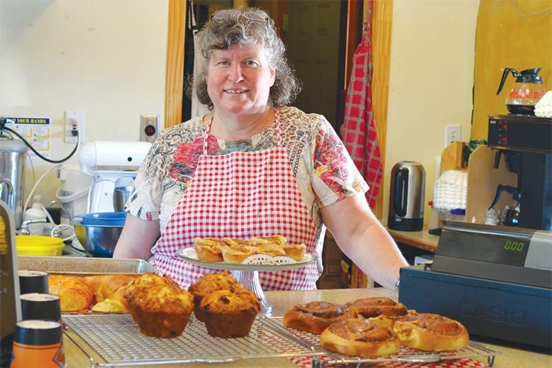 Bonnie Palmer with muffins, cinnamon buns, and tarts
