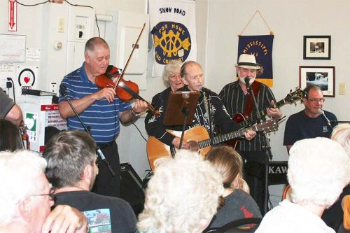 The band (Mark Hannah, Eric Labelle, Walter Cameron, Marlyn Schlievert, Eddie Ashton and Kevin Topping) entertained a packed house as Snow Road Station celebrated the official opening of its former schoolhouse into a community centre last Saturday. Photo/Craig Bakay