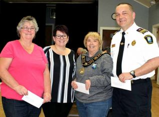 Mayor Frances Smith and committee member Coun. Cindy Kelsey presented cheques to Janet Barr representing the Treasure Trunk and Dep. Chief Jamie Riddell representing the Central Frontenac Fire Department distributing the proceeds from the 2019 Frontenac Heritage Festival Polar Bear Plunge. The Fire Department received $1,447.50, The Treasure Trunk$1,335 and Northern Connections will receive $969.50.