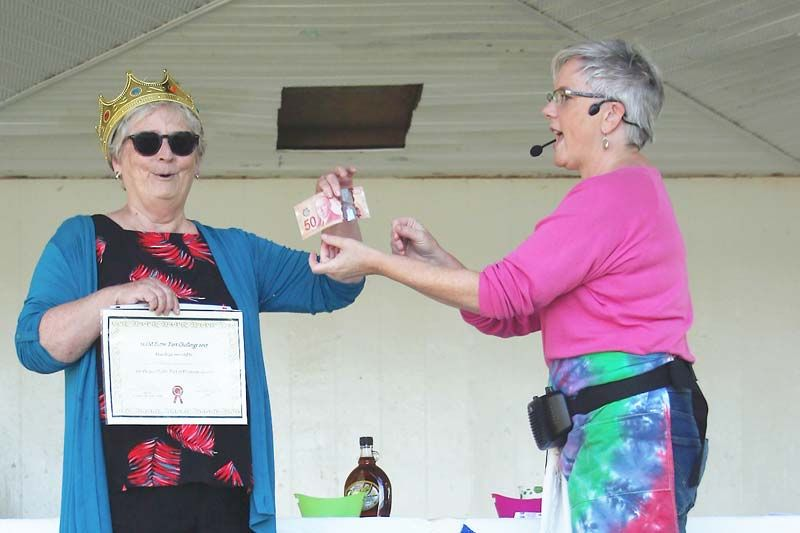 Shelley Brooks took home the top prize at the Sharbot Lake Farmers Market Butter Tart Challenge Saturday. Presenting the award was emcee Andrea Duggan. Photo/ Craig Bakay