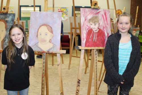 Denver Arrey and Rachel Gray with their self-portraits at the LOLPS art club show last Wednesday in Mountain Grove. Photo/Craig Bakay